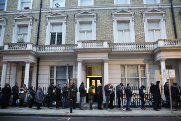 People queue to buy a copy of Charlie Hebdo as it goes on sael in London