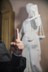 the judge's hand with a raised thumb as a sign of attention