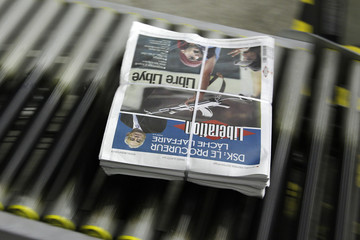 View of front page of the French daily morning newspaper Liberation at their printing press in La Courneuve