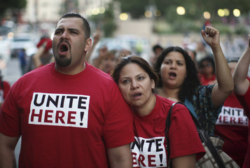 Coria and Racha chant as gas company workers and their supporters protest possible wage and benefit cuts in Los Angeles