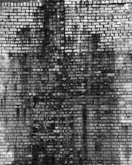 Old brick wall in grunge style. Background, texture of a brick. Free space for your design. A blank for creativity