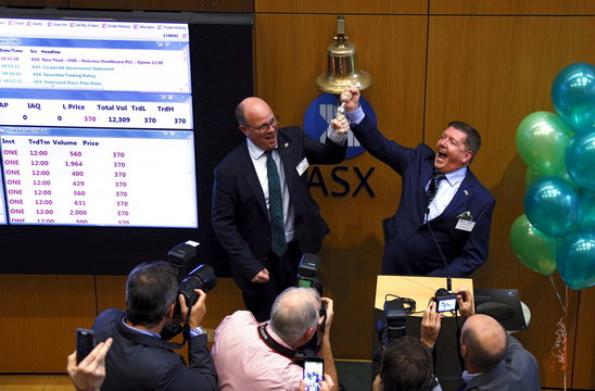 Irish health software maker Oneview's Chief Executive Officer Fitter and founder and executive director McCloskey react after they broke the rope ringing the bell at the ASX during the official listing ceremony in Sydney