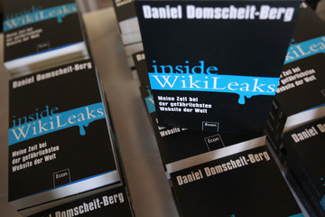 """Copies of book """"Inside WikiLeaks"""" are on display before news conference by author Domscheit-Berg in Berlin"""