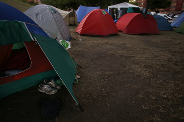 """The banners """"Yes we can"""" (green) are posted on tents at a camp set up by an unemployed assembly group in Madrid"""