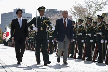 Accompanied by Japan's Defence Minister Onodera, U.S. Secretary of Defense Hagel reviews honor guards at the Japanese Ministry of Defence in Tokyo
