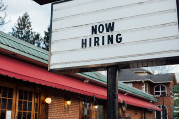 Authentic american sign in black letters over white luminous board looking for job opportunities hiring expats and immigrants