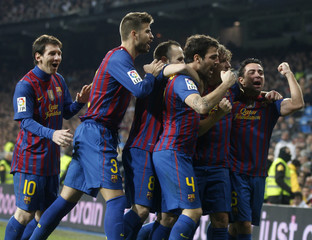 Barcelona's Puyol celebrates with team mates after scoring against Real Madrid during their Spanish King's Cup soccer match in Madrid