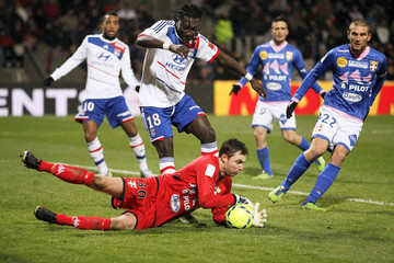 Olympique Lyon's Gomis challenges Andersen of Evian Thonon Gaillard during their French Ligue 1 soccer match at the Gerland stadium