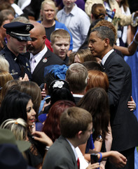 U.S. President Barack Obama greets family members during the National Peace Officers Memorial service on Capitol Hill in Washington
