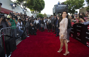 """Actress Dewan poses at the premiere of """"22 Jump Street"""" in Los Angeles"""