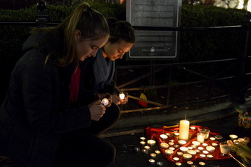 People gather at a makeshift memorial for the victims of the Belgium attacks in Brussels, at Union Square in the Manhattan borough in New York