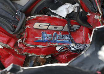 A damaged Volkswagen Golf (VW) logo is seen on a car's back at a scrapyard in Fuerstenfeldbruck