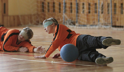 Women who are blind or visually impaired attend a goalball training session in Vitebsk