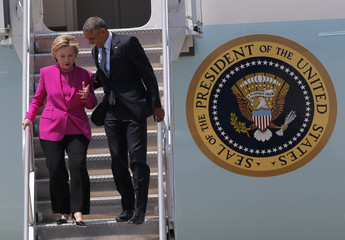 U.S. President Obama and Democratic U.S. presidential candidate Clinton descends stairs of Air Force One after arriving in Charlotte, North Carolina