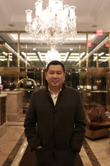 Indonesian businessman Hary Tanoesoedibjo poses for a picture in the lobby of the Trump International Hotel & Tower in Manhattan