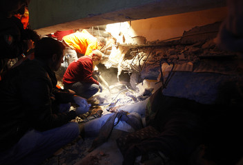 Rescue workers search for survivors trapped under debris after an earthquake in Ercis, near the eastern Turkish city of Van