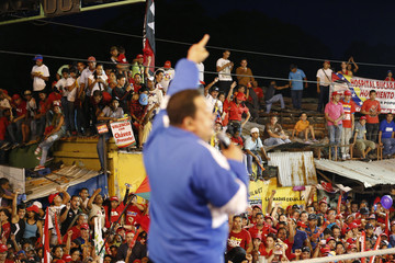 Venezuela's President and presidential candidate Chavez talks to supporters during a campaign rally in Valencia