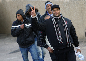Migrants from North Africa arrive on the southern Italian island of Lampedusa