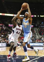Atlanta Hawks' Johnson defends against Denver Nuggets' Brewer during their NBA basketball game in Atlanta