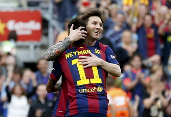 Barcelona's Messi celebrates his second goal against Deportivo de la Coruna with his team mate Neymar during their Spanish first division soccer match at Nou Camp stadium in Barcelona