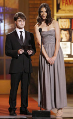 Presenters Holmes and Radcliffe speak on stage at the American Theatre Wing's 64th annual Tony Awards ceremony in New York