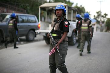 U.N. police officers patrol a street in Port-au-Prince