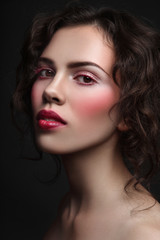 Vintage style portrait of young beautiful girl with stylish make-up