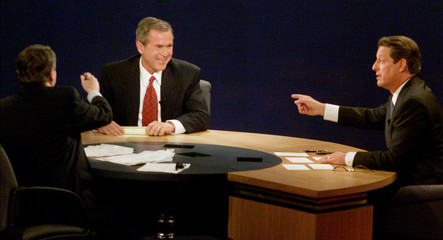 Bush laughs while Gore and moderator Lehrer respond during the second presidential debate at Wake Forest University in Winston-Salem, North Carolina