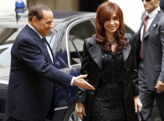Italian Prime Minister Berlusconi welcomes Argentina's President Cristina Fernandez de Kirchner during a meeting at Chigi Palace in Rome