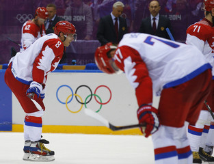 Russia's Ovechkin and Belov react after their loss to Finland during their men's quarter-finals ice hockey game at the Sochi 2014 Winter Olympic Games