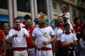 A man wears a horse's head mask at the San Fermin festival in Pamplona