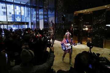 "Robert Burck, known as the original ""Naked Cowboy"", sings inside the lobby at Trump Tower where U.S. President Elect Donald Trump lives in New York"