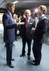 U.S. Secretary of State Kerry, French FM Fabius and Austria's FM Kurz discuss before a plenary session at the United Nations building in Vienna