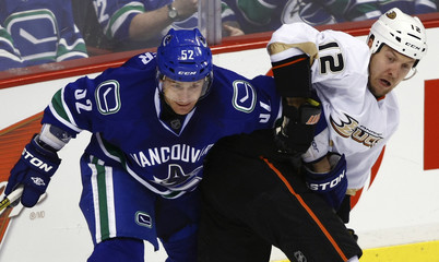 Canucks Sulzer fights for the puck against Ducks Hagman during their NHL hockey game in Vancouver.