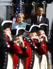German Chancellor Merkel  and U.S. President Obama watch the Old Guard during an official State Arrival ceremony fin Washington