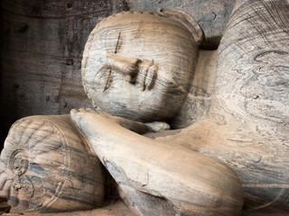 The reclining figure of buddha at Gal Vihara, Polonnaruwa, Sri Lanka. One of the best examples of ancient sinhalese sculpture.