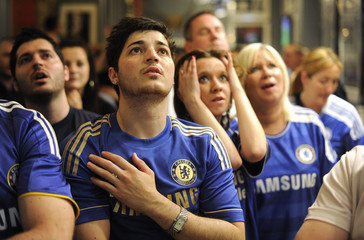 Chelsea fans react in a pub in London as their team play Bayern Munich in the final of the Champions League