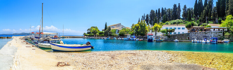 Foto op Aluminium Stad aan het water Boats in port Kouloura in Corfu, Greece