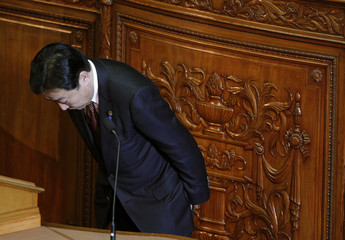 Japan Prime Minister Yoshihiko Noda bows after speaking at a lower house plenary session at the parliament in Tokyo