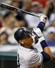 New York Yankees Alex Rodriguez flys out during the eighth inning of their baseball game against the Cleveland Indians in Cleveland