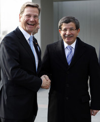 German FM Westerwelle, leader of Germany's liberal party, shakes hands with Turkey's Foreign Minister Davutoglu in Ankara