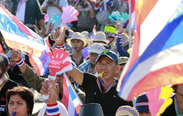 Anti-government protesters use a noise maker during a rally in central Bangkok