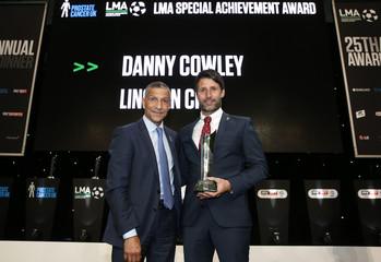 Brighton manager Chris Hughton presents Lincoln City manager Danny Cowley with the LMA Special Achievement award