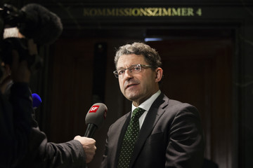 President of the Immunity Committee of the National Council Brand speaks to media before committee meeting in Bern