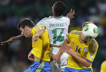 Nwakali of Nigeria fights for the ball with Engvall of Sweden during their U-17 UAE World Cup semi-final soccer match in Dubai