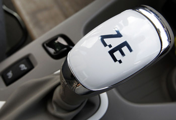 The gear shift of a Renault Zoe new electric car displayed at a Renault automobile dealership, reads Z.E (Zero Emission) in La Teste