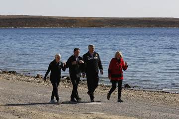 Canada's PM Harper and his wife Laureen walk with Ocean Networks Canada president Moran and University of Victoria president Cassels in Cambridge Bay