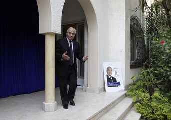 Former prime minister and presidential candidate Ahmed Shafiq gestures at the beginning of a news conference in Cairo