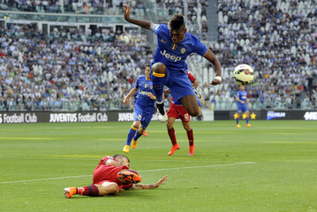 Juventus Pogba challenges Cagliari's Balzano during their Serie A soccer match at the Juventus stadium in Turin