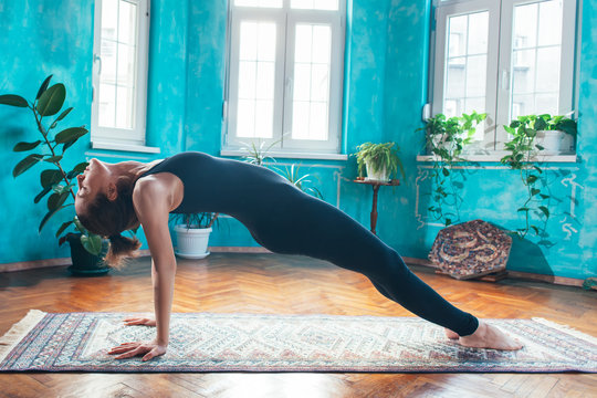 young woman in reverse plank yoga pose